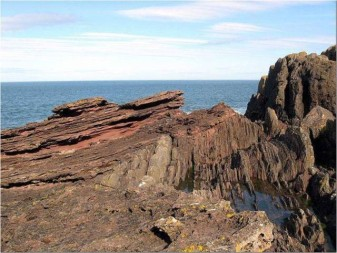 "Angular Unconformity at Siccar Point, Scotland. Siccar Point, Scotland (Photo: Wikipedia ""Hutton's Unconformity"")"